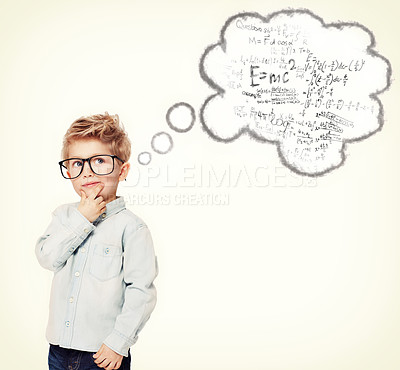 Buy stock photo Studio shot of an adorable little boy solving equations in his head