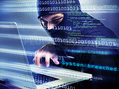 Buy stock photo Shot of a man in a balaclava using a laptop to steal information with a graphic overlay of streaming data