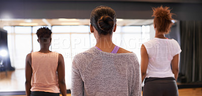 Buy stock photo Rear view shot of a group of young dancers standing together in a studio