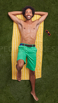 Buy stock photo A young african man relaxing on the grass