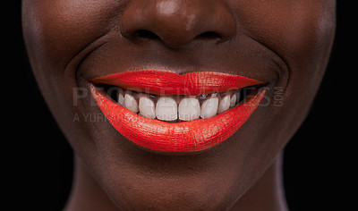 Buy stock photo Cropped view of an african woman with bright red lips on a black background