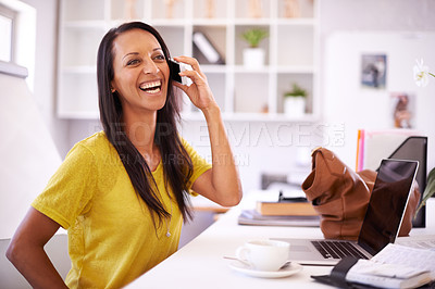 Buy stock photo An attractive businesswoman laughing as she speaks on her cellphone