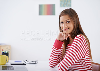 Buy stock photo Portrait of a young woman sitting at a desk