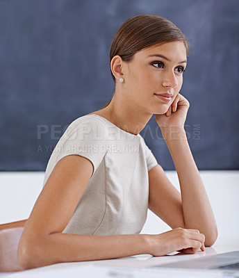 Buy stock photo Cropped shot of a young business woman working at a desk