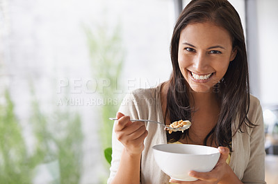 Buy stock photo A lovely young woman enjoying a healthy salad
