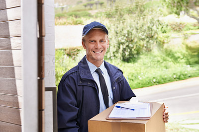 Buy stock photo A friendly delivery man delivering a package to a home
