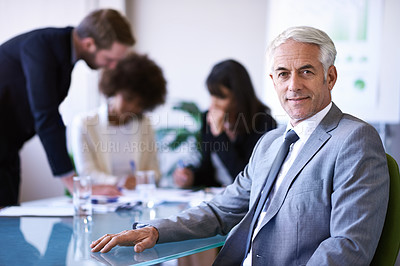 Buy stock photo Cropped shot of a group of business colleagues meeting in the boardroom