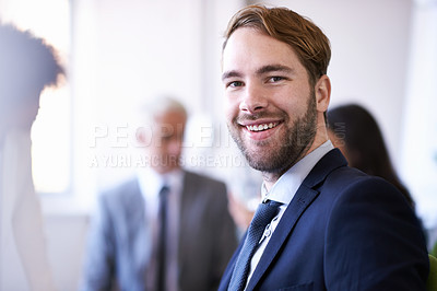 Buy stock photo Cropped view of a young businessman smiling while in a meeting
