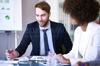 Buy stock photo Cropped shot of two business associates working together