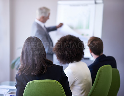 Buy stock photo A cropped view of a businessman giving a presentation to his coworkers