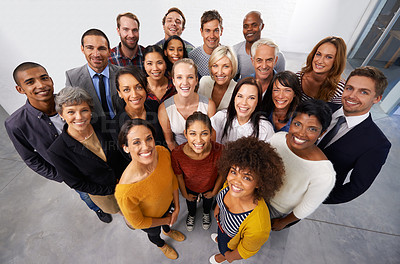 Buy stock photo High angle shot of a diverse group of business professionals