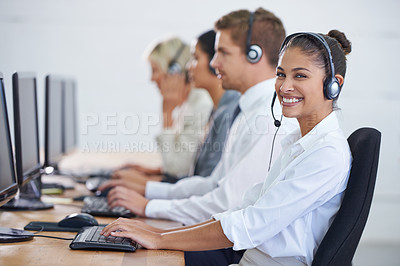 Buy stock photo Shot of an attractive young woman sitting next to her colleagues