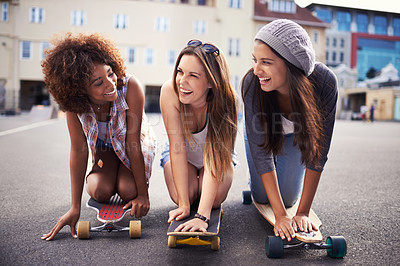 Buy stock photo Shot of a group of young women out skateboarding together