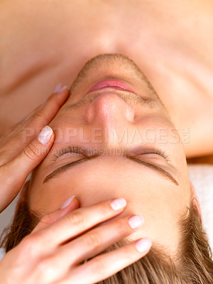 Buy stock photo Young happy man receiving facial massage by female hands. Enjoying a healthy holiday at the day spa.