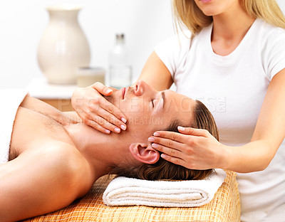 Buy stock photo Beautiful female therapist giving facial massage to young handsome man