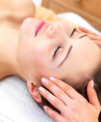 Buy stock photo Close up portrait of a young woman with eyes closed receiving facial massage