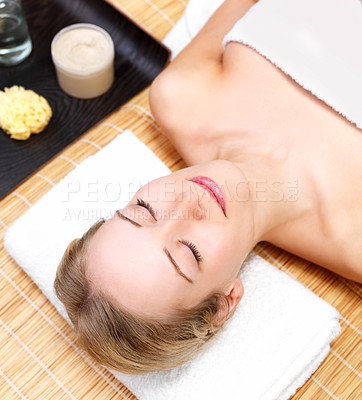 Buy stock photo Young lady lying with eyes closed, elevated view, close-up, ready for a skin care treatment at the day spa