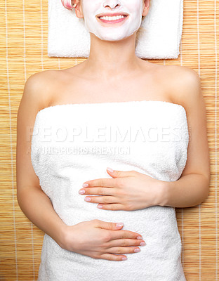 Buy stock photo Beautiful woman wearing facial mask on mat at spa, picture taken from above
