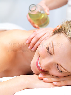 Buy stock photo Portrait of a pretty young girl getting a massage at the day spa