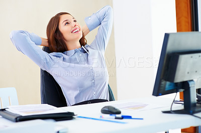 Buy stock photo Pretty businesswoman sitting on an office chair and relaxing with hands behind head