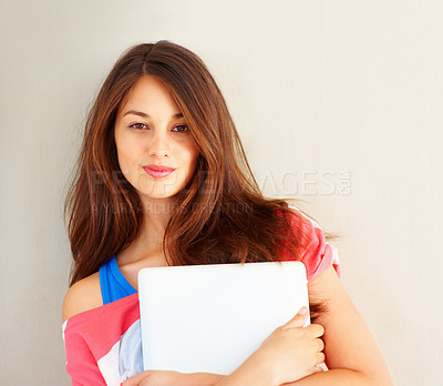 Buy stock photo Portrait of young girl holding laptop and giving you cute smile