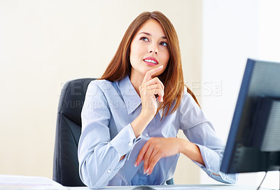 Buy stock photo Cute young businesswoman in deep thought sitting at an office table