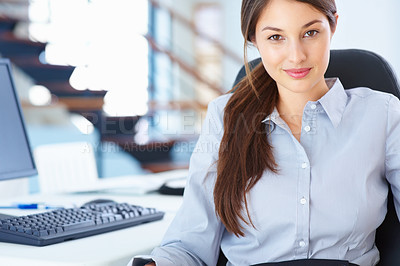 Buy stock photo Portrait of an attractive businesswoman sitting on an office chair