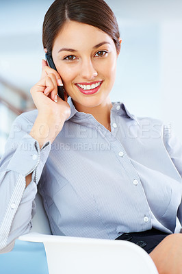 Buy stock photo Portrait of smiling young businesswoman sitting on chair and using cellphone