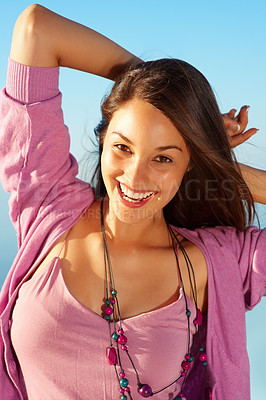 Buy stock photo Portrait of happy young woman standing against sky and enjoying