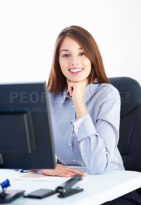 Buy stock photo Portrait of happy young businesswoman sitting at an office table