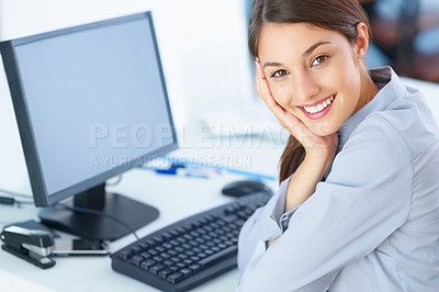 Buy stock photo Portrait of beautiful young female executive sitting at an office desk and smiling back at you - copyspace