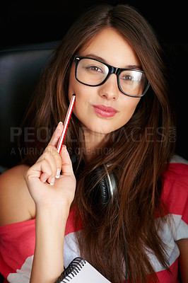 Buy stock photo Closeup of cute young girl in retro glasses sitting on chair with pen and notepad