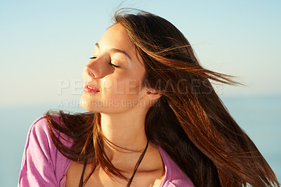 Buy stock photo Closeup of beautiful young female facing the sun and enjoying the weather