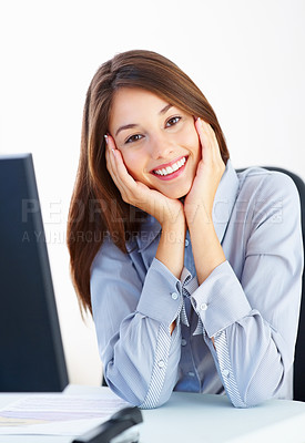 Buy stock photo Portrait of cute business woman sitting at office table with head in hands and smiling