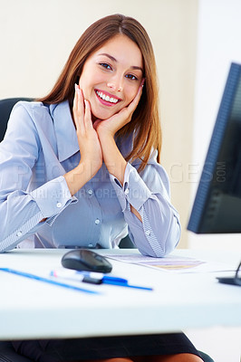 Buy stock photo Portrait of beautiful business woman sitting at office table and giving you an attractive smile