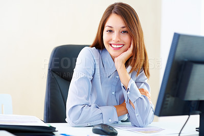 Buy stock photo Portrait of beautiful young business woman sitting at an office table and smiling