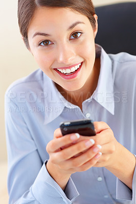 Buy stock photo Closeup of young female executive using cellphone and giving you an attractive smile