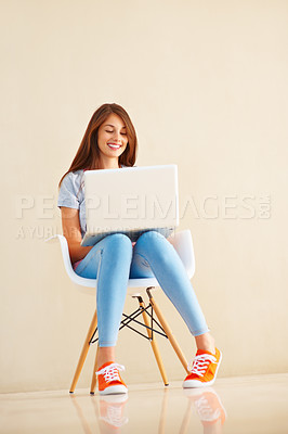 Buy stock photo Full length of beautiful woman sitting on chair using laptop and smiling