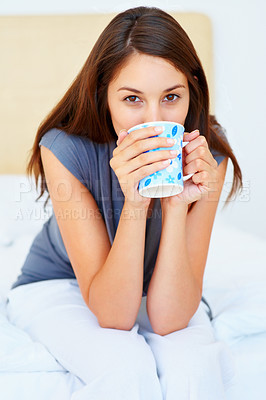 Buy stock photo Beautiful young woman having coffee on bed