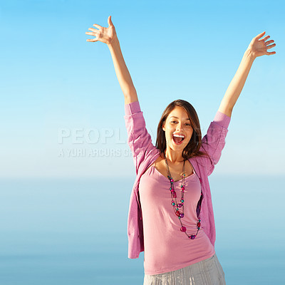 Buy stock photo Cheerful young woman with spreading arms to sky - copyspace