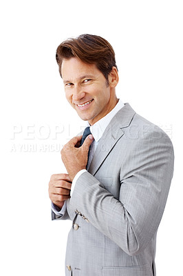 Buy stock photo Portrait of a successful young businessman adjusting his necktie isolated against white background