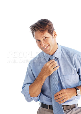 Buy stock photo Portrait of happy young businessman adjusting tie against white background
