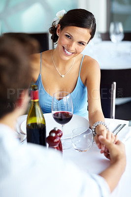Buy stock photo Portrait of young attractive woman with her boyfriend at the restaurant holding hand and smiling