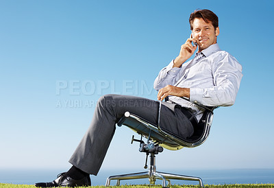 Buy stock photo Portrait of a young businessman sitting relaxed on chair and using cellphone - Outdoor