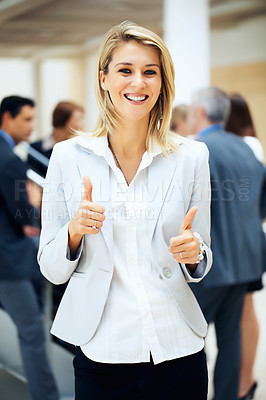 Buy stock photo Focus on woman with thumbs up with colleagues in background