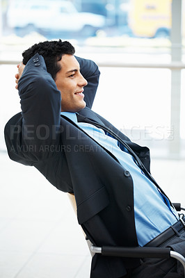 Buy stock photo Businessman leaning back in chair with hands behind head