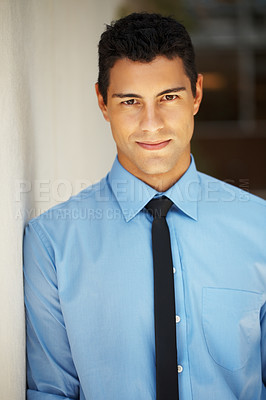 Buy stock photo Portrait of confident young man leaning against wall