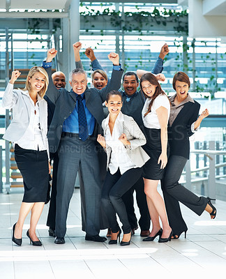 Buy stock photo Full length of colleagues smiling and throwing arms up in excitement
