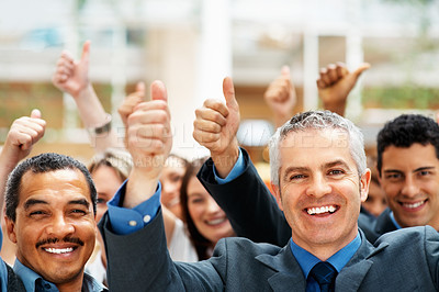 Buy stock photo Group of executives holding thumbs up while smiling
