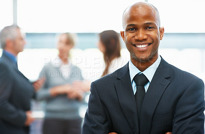 Buy stock photo Portrait of confident executive with colleagues in background